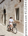 Young woman riding city bicycle near sea 45150443