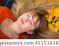 Teenage girl portrait in autumnal scenery 45151618