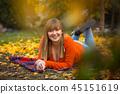 Happy teenage girl portrait in autumnal scenery 45151619
