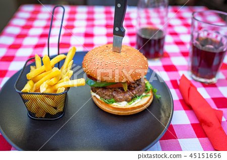 Tasty hamburger with grilled beef and chips 45151656