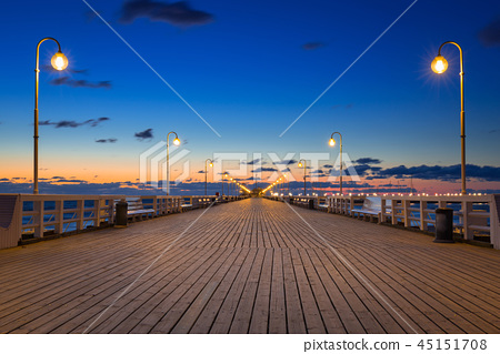 Baltic sea pier in Sopot at sunrise, Poland 45151708