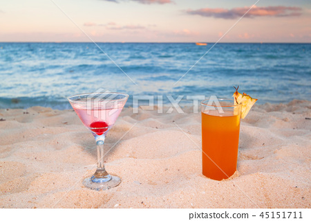 Tropical drinks at the caribbean beach of Mexico 45151711