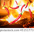 few pieces of chili peppers and fire 45151773