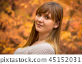Teenage girl portrait in autumnal scenery 45152031