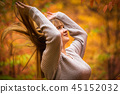 Happiness of teenage girl in autumnal scenery 45152032