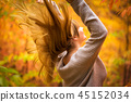 Happiness of teenage girl in autumnal scenery 45152034
