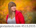 Teenage girl portrait in autumnal scenery 45152035