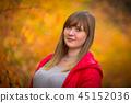 Teenage girl portrait in autumnal scenery 45152036
