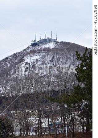 Hakodate mountain in winter seen from a green island 45162998