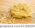 Uncooked instant chinese noodles. 45169569