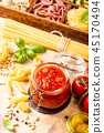 Glass jar with homemade classic spicy tomato pasta or pizza sauce. 45170494