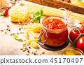 Glass jar with homemade classic spicy tomato pasta or pizza sauce. 45170497