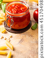 Glass jar with homemade classic spicy tomato pasta or pizza sauce. 45170498