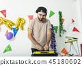 Charismatic disc jockey DJ music player having fun 45180692