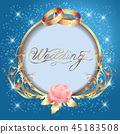 Wedding golden rings and round frame 45183508