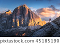Woman on the trail looking on mountain peak  45185190