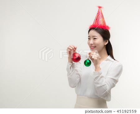 Christmas Day. Korea woman holding xmas props 45192559