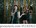 young lady singer with birthday hat celebrating 45192922