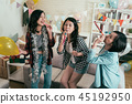young girls having fun with blowers 45192950