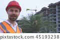 Man in a helmet, architect, engineer, manager tells about the progress of construction in evening 45193238