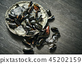 fresh delicious raw mussels with ice on an old silver plate 45202159