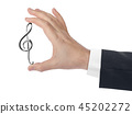 Hand holding a treble clef 45202272