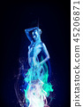 Sexy beautiful woman with sparks on skin in blue fire flames. 45206871