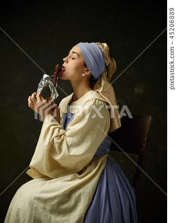 Medieval Woman in Historical Costume Wearing Corset Dress and Bonnet. 45206889
