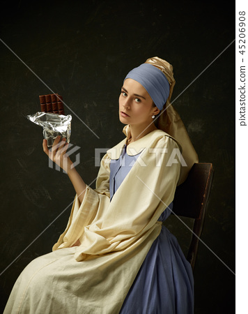 Medieval Woman in Historical Costume Wearing Corset Dress and Bonnet. 45206908