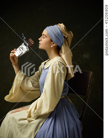 Medieval Woman in Historical Costume Wearing Corset Dress and Bonnet. 45206909