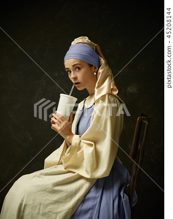 Medieval Woman in Historical Costume Wearing Corset Dress and Bonnet. 45208144
