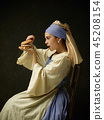 Medieval Woman in Historical Costume Wearing Corset Dress and Bonnet. 45208154