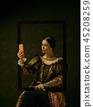 Portrait of a girl wearing a retro princess or countess dress 45208259