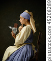 Medieval Woman in Historical Costume Wearing Corset Dress and Bonnet. 45208289