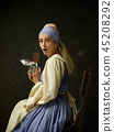 Medieval Woman in Historical Costume Wearing Corset Dress and Bonnet. 45208292