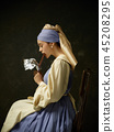 Medieval Woman in Historical Costume Wearing Corset Dress and Bonnet. 45208295