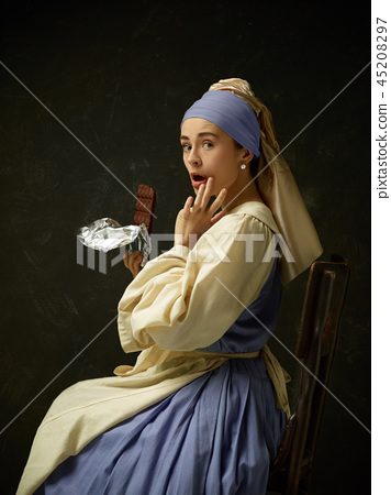 Medieval Woman in Historical Costume Wearing Corset Dress and Bonnet. 45208297
