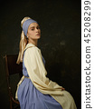 Medieval Woman in Historical Costume Wearing Corset Dress and Bonnet. 45208299