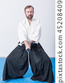 A man with katana on Iaido practice 45208409