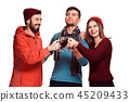 Smiling european men and women during party photoshoot. 45209433