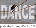 Mixed Race Kid is Stretching near Ballet Bar. 45210274