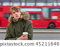 Male Adult Teen Drinking Coffee By Red London Bus 45211646