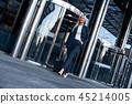 Travel, business trip. People and technology concept - happy young woman with travel bag 45214005