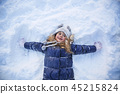 pretty little girl playing in snowy winter park 45215824