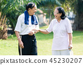Smiling senior couple standing in the park 45230207