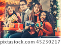 Diversity Friends with Christmas presents and bags shopping in mall 45230217