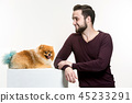 Emotional Portrait of a man and his dog, concept of friendship and care of man and animal 45233291