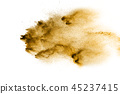 Brown particles splattered on white background. 45237415