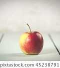 Apple on white wooden background 45238791