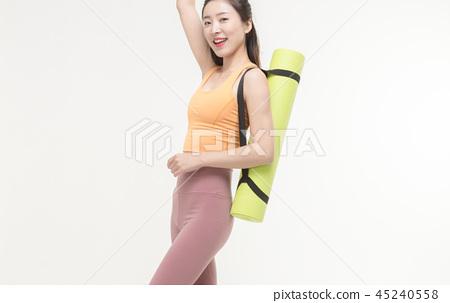 Korean woman with yoga mat 45240558